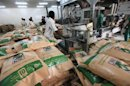 Employees pack refined sugar at Kenana Sugar Company, south of Khartoum
