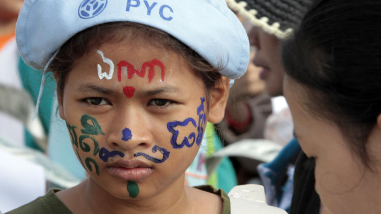 "A Cambodian garment factory worker is her face painted with letters which reads ""Where is justice"" as she joins a rally on May Day in Phnom Penh, Cambodia, Wednesday, May 1, 2013. They demand the government an increase in wages and better working condition. (AP Photo/Heng Sinith)"