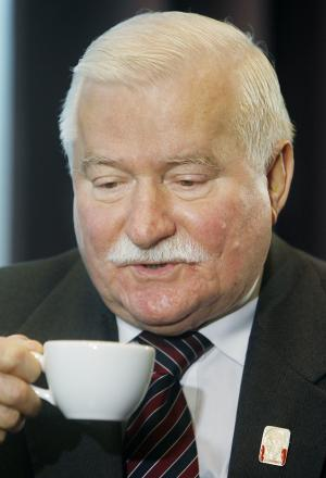 Poland's former president and Solidarity founder, Lech Walesa, takes a sip of tea before talking to The Associated Press in Warsaw, Poland, on Friday, May 23, 2014 on the sidelines of a conference of an organization of engineers and appraisers, SIDiR, that he addressed. Walesa told the AP that the United States under President Obama is not a world leader anymore, at a time when leadership is needed. (AP Photo/Czarek Sokolowski)