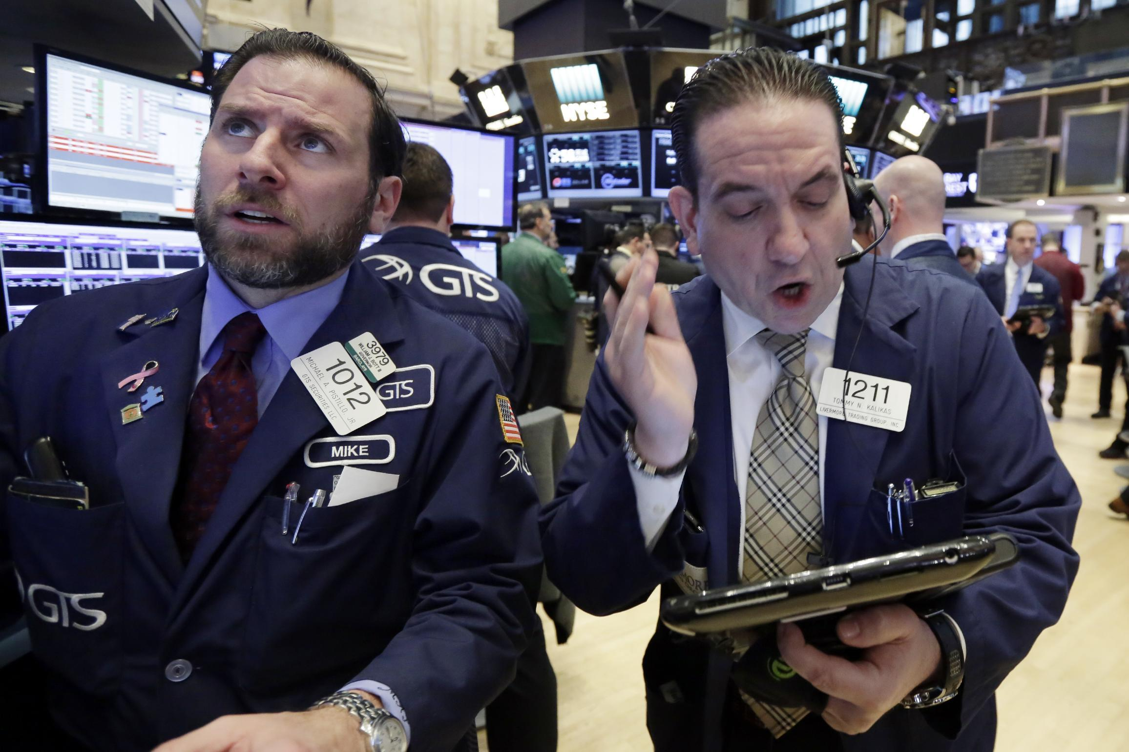 US stock indexes veer lower in morning trading; oil slides