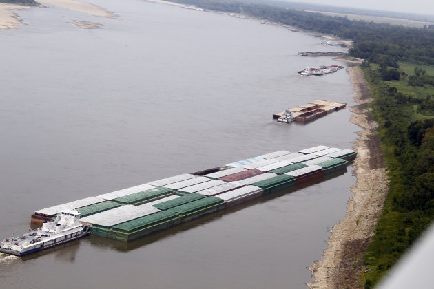 Barges and their towboats accumulate alongside the Mississippi banks of the Mississippi River near Greenville, Miss., Tuesday, Aug. 21, 2012. Officials with the U.S. Army Corps of Engineers say low wa