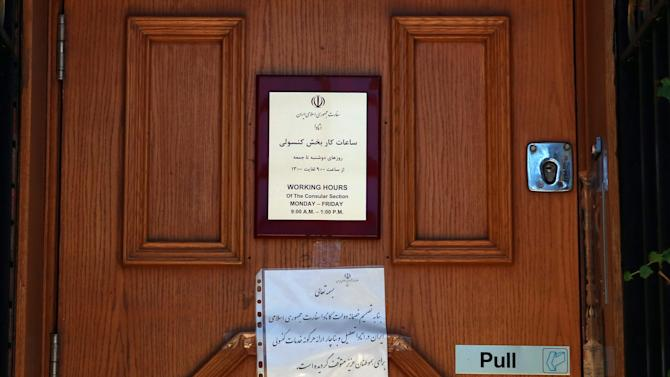 The door of the Iranian embassy in Ottawa is shown Friday Sept. 7, 2012.  The Canadian government says it is shutting its embassy in Tehran and severing diplomatic relations amid recent attacks on foreign diplomats in Iran. Foreign Affairs Minister John Baird said Friday that the Canadian embassy in Tehran will close immediately and Iranian diplomats in Canada have been given five days to leave. He says he's worried about the safety of diplomats in Tehran following recent attacks on the British embassy there. He's also warning Canadians to avoid traveling to Iran. (AP Photo/The Canadian Press, Fred Chartrand)