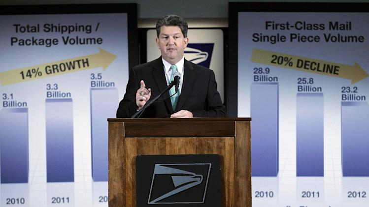 Postmaster General and CEO Patrick R. Donahoe speaks during a news conference at U.S. Postal Service headquarters on Wednesday Feb. 6, 2013 in Washington. The financially struggling U.S. Postal Service says it will stop delivering mail on Saturdays but continue to disburse packages six days a week. (AP Photo/Jose Luis Magana)