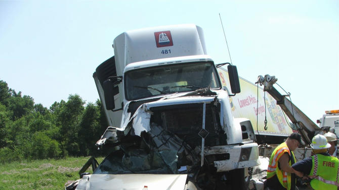 This handout photo provided by the Oklahoma Highway Patrol and the National Transportation Safety Board (NTSB), taken June 26, 2009, shows a tractor-trailer that crashed into cars on Interstate 44 near Miami. Oklahoma. On a clear June afternoon, a tractor-trailer truck crested a small rise on a stretch of interstate highway in Oklahoma. Plainly visible in the distance were more than a dozen cars and trucks that had stopped while a fender-bender was being cleared.  Instead of slowing, the 40,000-pound truck barreled ahead at nearly 70 mph, plowing into the traffic. It rode over three cars, dragging them under its wheels, and smashed others before finally halting. Ten people were killed. Investigators said later the 76-year-old truck driver had slept only about five hours the previous night. He'd been on the road almost 10 hours.  (AP Photo/Oklahoma Highway Patrol, NTSB)