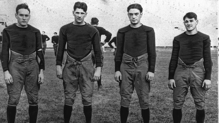 "FILE - In this 1924, file photo, Notre Dame's infamous backfield, ""The Four Horsemen,"" from left, Don Miller, Elmer Layden, Jim Crowley and Harry Stuhldreherare pose on the practice field in South Bend, Ind. Notre Dame, led by the famed Four Horsemen, finished 10-0 in 1925. There was no national champion declared at the time, but two years later University of Illinois economics professor Frank Dickinson devised a mathematical point system to determine a national champion, Stephens said. Notre Dame coach Knute Rockne persuaded Dickinson to retroactively determine a national champion for the 1925 (Dartmouth) and 1924 seasons. (AP Photo/File)"