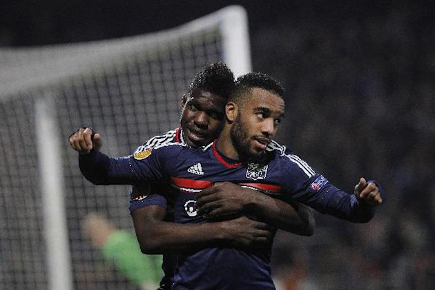 Lyon's Alexandre Lacazette, front, celebrates with Arnold Mvuemba after scoring a goal against Viktoria Plzen during their Europa League soccer match in Lyon, central France, Thursday, March 13, 2