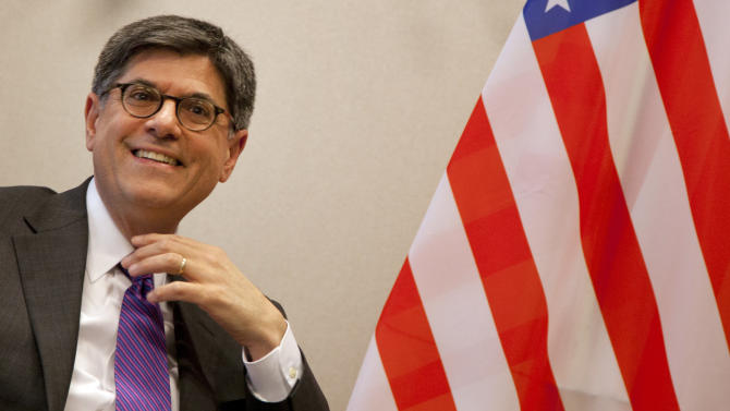 U.S. Treasury Secretary Jacob Lew smiles at journalists prior to a meeting with European Council President Herman Van Rompuy, not shown, at EU headquarters in Brussels on Monday, April 8, 2013. U.S. Treasury Secretary Jacob Lew is starting a series of meetings with key European Union leaders during his first official visit to the region. Lew is expected to urge the European officials to promote more growth-friendly policies to counter the debt crisis that has for three years engulfed the 27-nation bloc, which together forms the world's largest economy. (AP Photo/Virginia Mayo, Pool)