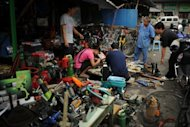 <p>People look at industrial tools on display at a market Shanghai in August 2012. China's purchasing managers' index (PMI) stood at 50.2 last month, up from 49.8 in September, according to the China Federation of Logistics and Purchasing and the National Bureau of Statistics.</p>