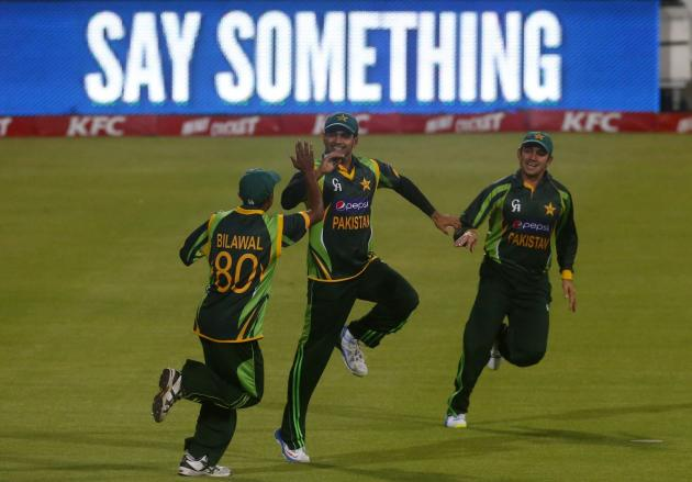 Pakistan's Mohammad Hafeez celebrates with team-mates Bilawal Bhatti and Ahmed Shehzad after Hafeez caught South Africa's Faf du Plessis during their second Twenty20 cricket match in Cape Town