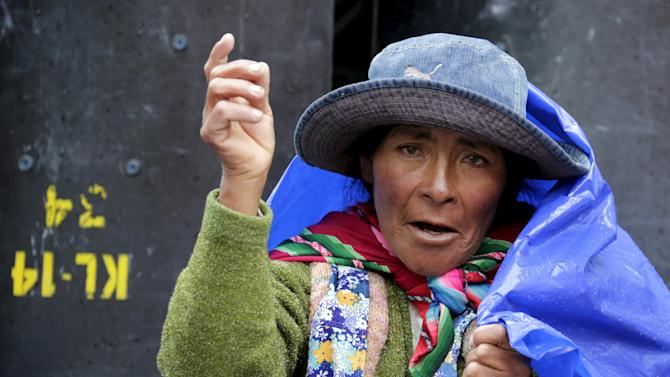 A woman attends a protest in La Paz
