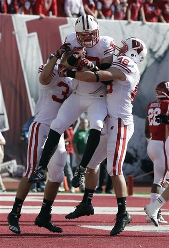 Ball's big day leads Wisconsin past Indiana 62-14