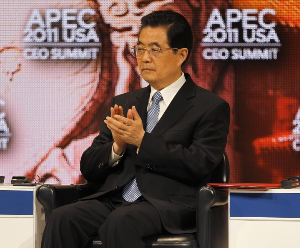 Chinese President Hu Jintao sits after addressing the APEC CEO Summit, a gathering of business leaders at the Asia-Pacific Economic Cooperation summit Saturday, Nov. 12, 2011, in Honolulu. (AP Photo/Andres Leighton)