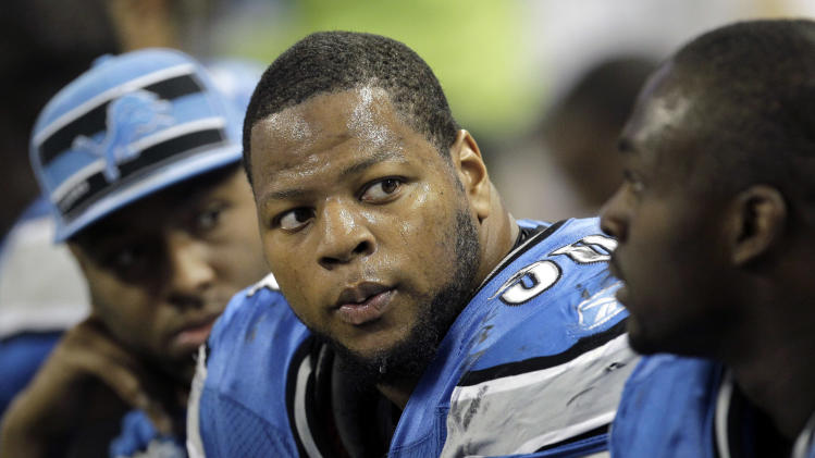 FILE - In this Nov. 20, 2011 file photo, Detroit Lions defensive tackle Ndamukong Suh (90) sits on the bench during the fourth quarter of an NFL football game against the Carolina Panthers, in Detroit. Suh is suspended for two games by the NFL for stomping on the arm of Green Bay's Evan Dietrich-Smith during a Thanksgiving game. (AP Photo/Carlos Osorio, File)