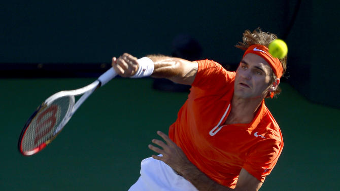 FILE - In this March 11, 2013 file photo, Roger Federer, of Switzerland, serves to Ivan Dodig, of Croatia, during their match at the BNP Paribas Open tennis tournament in Indian Wells, Calif. The French Open begins Sunday, May 26, 2013. (AP Photo/Mark J. Terrill, File)