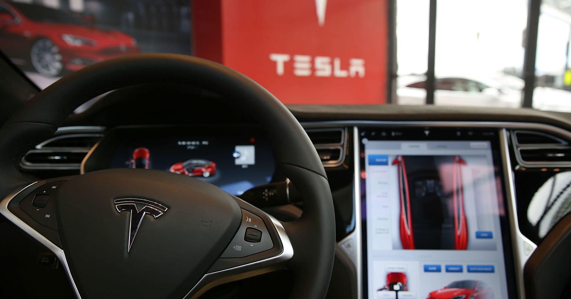 US traffic agency says 'no defect' at time of Tesla's fatal crash, Musk says report 'very positive'