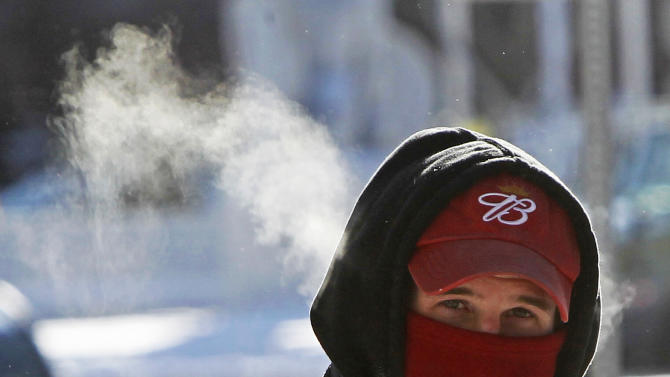 Steam rises from a pedestrian on Wednesday, Jan. 23, 2013 in Barre, Vt.  The National Weather Service said states from Ohio through to the far northeast of Maine could expect to be slammed by an Arctic blast on Wednesday.(AP Photo/Toby Talbot)