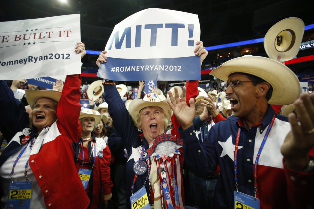 Texas delegates cheer as Mitt Romney is nominated for the Office of the President of the United States at the Republican National Convention in Tampa, Fla., on Tuesday, Aug. 28, 2012. (AP Photo/Jae C. Hong)