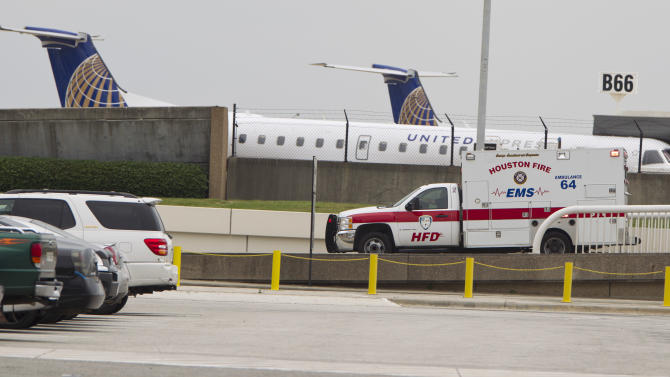 An EMS ambulance pulls out of of Terminal B at Bush Intercontinental Airport on Thursday, May 2, 2013 in Houston.   Shots were fired near a ticket counter, critically injuring one armed man and sending people in the terminal scrambling and screaming, a Houston police spokesman and witnesses said.   One person has been taken to an area hospital with life threatening injuries. It was not immediately clear who fired the shots.  (AP Photo/Houston Chronicle, Karen Warren ) MANDATORY CREDIT