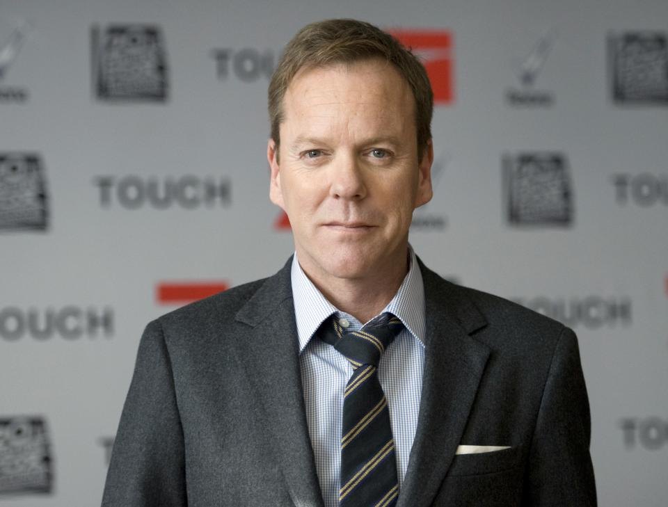 "Canadian born actor Kiefer Sutherland poses during a photo call for the U.S. TV series ""Touch"" in Berlin Germany, March 9, 2012. (AP Photo/dapd, Steffi Loos)"