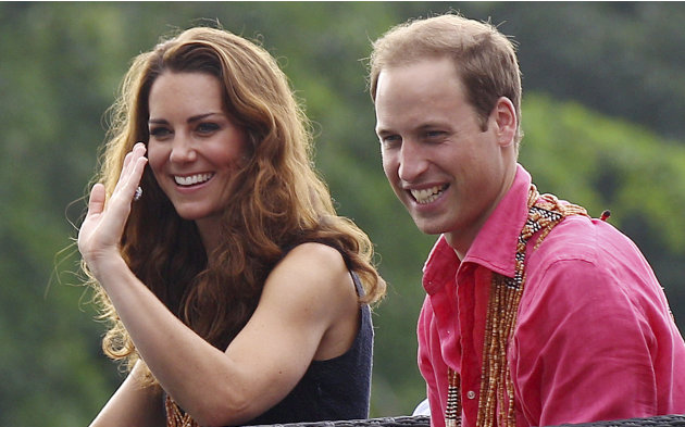 Britain's Prince William and his wife Kate, the Duke and Duchess of Cambridge, smile as they watch a shark ceremony as they arrive at Marapa Island, Solomon Islands, Monday, Sept. 17, 2012. (AP Photo/