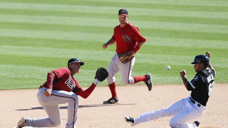 Arizona Diamondbacks shortstop Nick Ahmed tags out Chicago White Sox's Keenyn Walker at second base in the eighth inning during an exhibition baseball game in Glendale, Ariz., Saturday, March 8, 2014. (AP Photo/Paul Sancya)