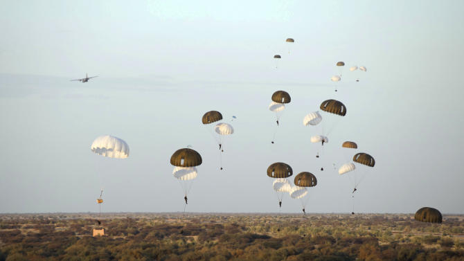 In this photo taken on Tuesday, Jan. 29, 2013, provided by the French Army Communications Audiovisual office (ECPAD) and released Friday, Feb. 1, 2013, French paratroopers drop from a plane over Timbuktu airport as part of the Operation Serval in Mali . France's military intervention in Mali has entered the fourth week, after rapidly forcing Islamists' retreat from major towns. (AP Photo/ ECPAD, Olivier Debes)