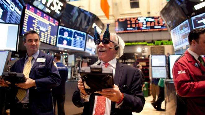 A trader wearing New Years party glasses works on the floor of the New York Stock Exchange on Dec. 31.