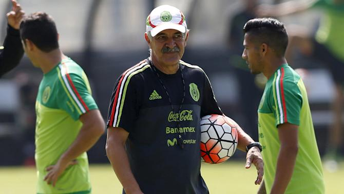 Mexico's national soccer team coach Ricardo Ferreti holds a ball during a soccer training session in Mexico City