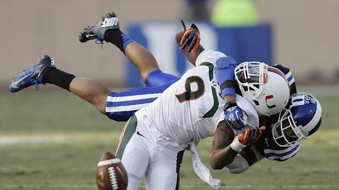 Duke's Jeremy Cash, right, breaks up a pass intended for Miami's Malcolm Lewis (9) during the first half of an NCAA college football game in Durham, N.C., Saturday, Nov. 16, 2013