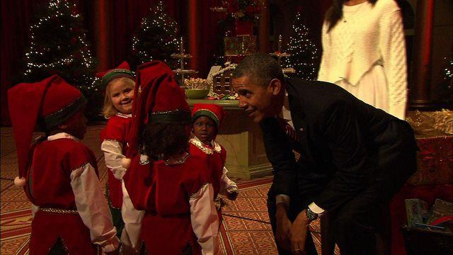 Obamas pose with elves, reflect on Christmas lessons at holiday concert