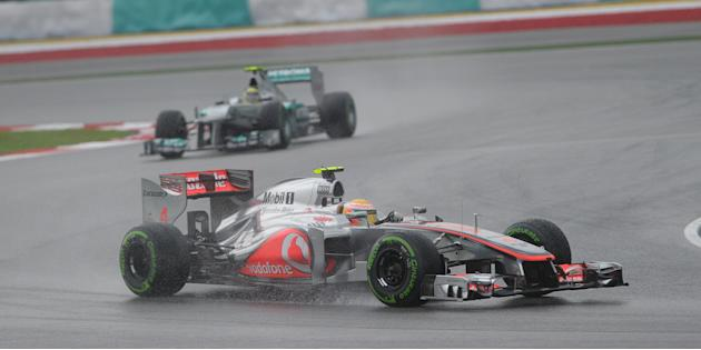 McLaren-Mercedes driver Lewis Hamilton of Britain powers his car during Formula One's Malaysian Grand Prix at the Sepang International Circuit in Sepang on March 25, 2012. AFP PHOTO/ Prakash SINGH (Ph