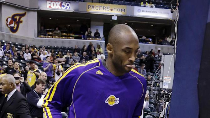 Los Angeles Lakers guard Kobe Bryant takes the court before the start of an NBA basketball game against the Indiana Pacers  in Indianapolis, Friday, March 15, 2013. Bryant is expected to play against the Pacers after injuring his ankle on Wednedsday.  (AP Photo/Michael Conroy)