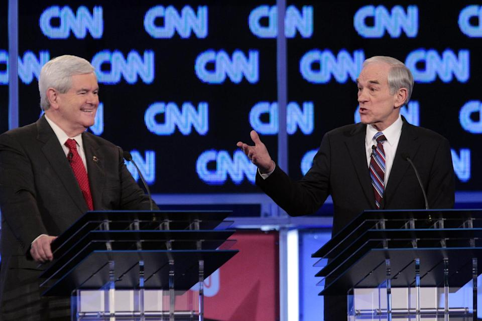 Republican presidential candidates, former House Speaker Newt Gingrich and Rep. Ron Paul, R-Texas, participate in the Republican presidential candidate debate at the North Charleston Coliseum in Charleston, S.C., Thursday, Jan. 19, 2012. (AP Photo/David Goldman)