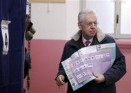 Outgoing Prime Minister Mario Monti holds his election ballot before casting his vote at the polling station in Milan, February 24, 2013. Italians began voting on Sunday in one of the most closely watched elections in years, with markets nervous about whether it can produce a strong government to pull Italy out of recession and help resolve the euro zone debt crisis. REUTERS/Stefano Rellandini