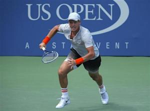 Berdych of the Czech Republic runs to the net for a return from Benneteau of France at the U.S. Open tennis championships in New York