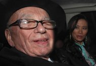News Corp Chief Rupert Murdoch and his wife Wendi Deng drive away from the High Court in central London on April 25. Murdoch has admitted there was a &quot;cover-up&quot; over phone hacking at Britain&#39;s News of the World tabloid but tried to shift the blame away from himself and senior executives at his media empire