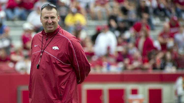 In this April 20, 2013, file photo, Arkansas head coach Bret Bielema watches his team warm up before of a spring NCAA college football game in Fayetteville, Ark. Bielema felt much more at ease at Arkansas in his second spring with the program. With the spring completed, the Razorbacks coach now hopes that comfort level translates into more wins for the school next season