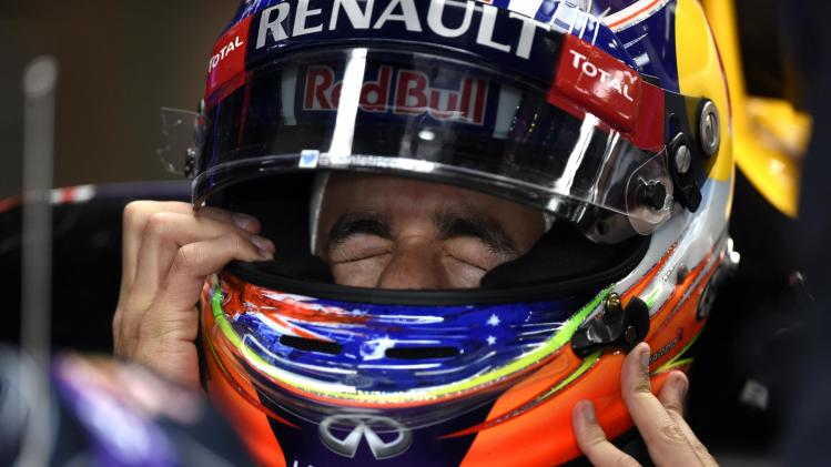 Ricciardo put on his helmet in the pit during a practice session ahead of the weekend's Belgian F1 Grand Prix in Spa-Francorchamps