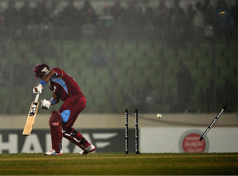 West Indies batsman Dwayne Smith is clean bowled by Bangladesh cricketer Rubel Hossain during the T20 match between Bangladesh and West Indies at the Sher-e-Bangla National Cricket Stadium in Dhaka on