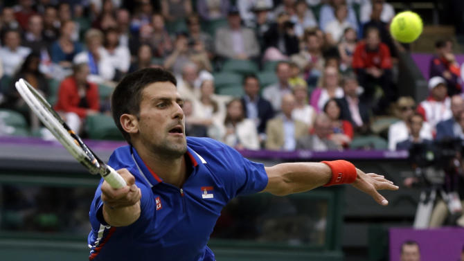 Novak Djokovic of Serbia returns to Andy Roddick of the United States at the All England Lawn Tennis Club in Wimbledon, London at the 2012 Summer Olympics, Tuesday, July 31, 2012. (AP Photo/Elise Amendola)