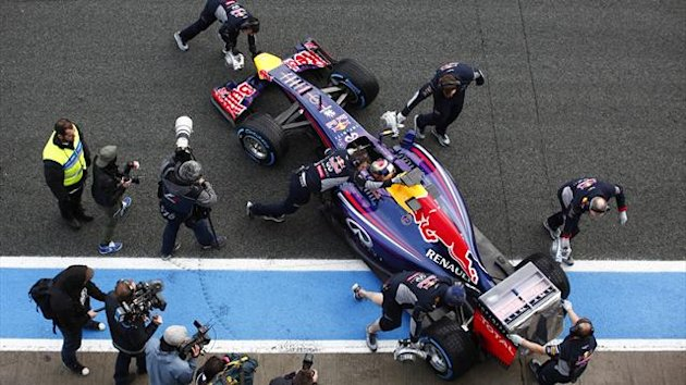 Red Bull Formula One driver Sebastian Vettel of Germany sits inside his RB10 as team members push his car into the garage during pre-season testing at the Jerez racetrack in southern Spain January 29, 2014 (Reuters)