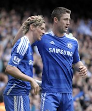 Chelsea&#39;s Fernando Torres (L) celebrates scoring his second goal with teammate Gary Cahill, against Leicester City, during their FA Cup quarter-final match at Stamford Bridge in London, on March 18. Chelsea advanced to the semis where they will play Tottenham, on Sunday