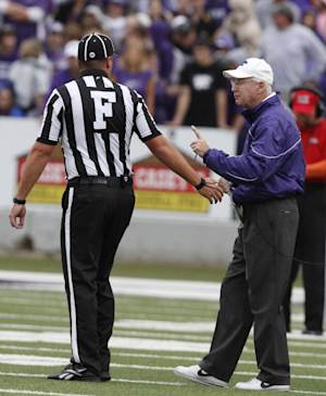 Kansas State head coach Bill Snyder, right, questions a call with the referee during the second quarter of an NCAA college football game against Missouri in Manhattan, Kan., Saturday, Oct. 8, 2011. (AP Photo/Jeff Tuttle)