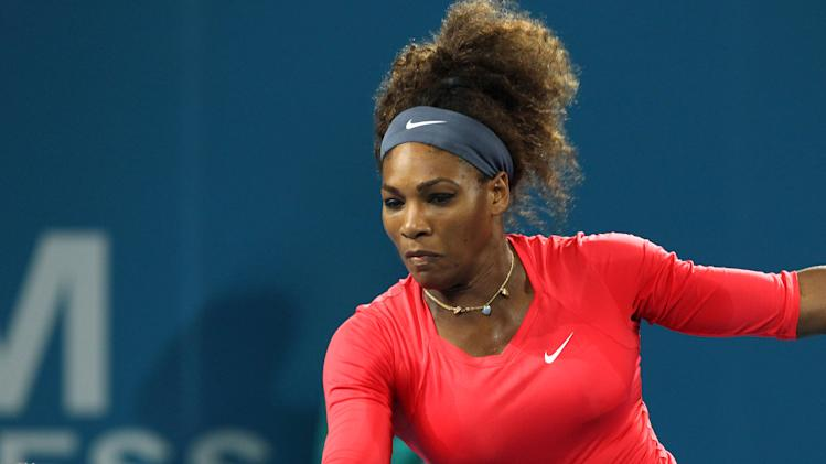 Serena Williams of the United States plays a shot in the women's final match against Anastasia Pavlyuchenkova of Russia at the Brisbane International tennis tournament in Brisbane, Australia, Saturday, Jan 5, 2013. Williams won 6-2, 6-1. (AP Photo/Tertius Pickard)