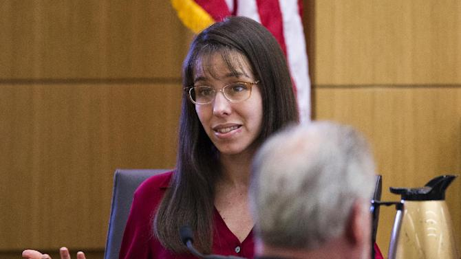 FILE - In this March 7, 2013 file photo, Jodi Arias answers written questions from the jury in Maricopa County Superior Court in Phoenix during her trial for the 2008 killing of her boyfriend, Travis Alexander. Psychologist Richard Samuels, who diagnosed Arias with post-traumatic stress disorder and amnesia, returns to the witness stand for a sixth day of testimony Monday, March 25, 2013. (AP Photo/The Arizona Republic, Tom Tingle, Pool, File)