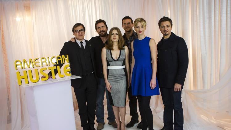 """American Hustle"" director Russell poses with cast members Bale, Adams, Cooper, Lawrence and Renner in New York"