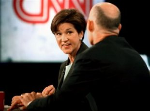 Alex Sink turns to Rick Scott during Monday's Florida Governor debate.