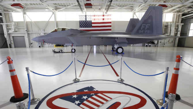One of the last F-22's is on display in a hanger during a media availability at Langley Air Force Base in Hampton, Va., Monday, April 30, 2012. The Hat in Ring logo is from the 94th fighter squadron based at Langley.   (AP Photo/Steve Helber)
