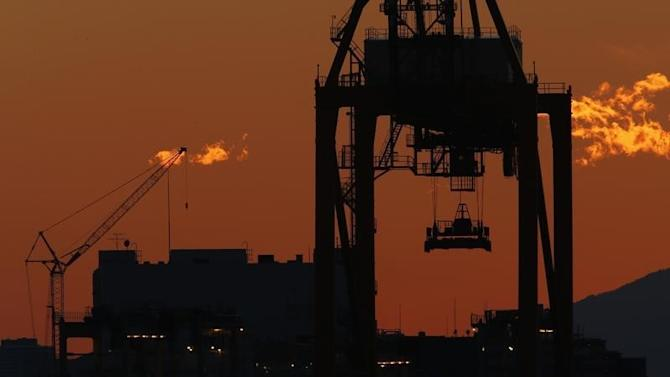 A crane is seen at an industrial port in Tokyo