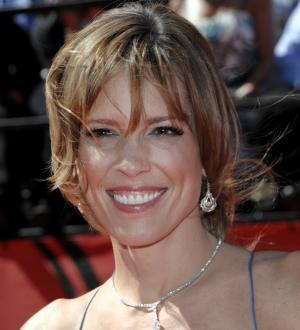 FILE  - In this July 14, 2010, file photo, ESPN anchor Hannah Storm arrives at the ESPY Awards in Los Angeles. Storm returned to the air on New Year's Day, exactly three weeks after she was seriously burned in a propane gas grill accident at her home. Storm, who suffered second-degree burns on her chest and hands, and first-degree burns to her face and neck, hosted ABC's telecast of the 2013 Rose Parade on Tuesday. (AP Photo/Dan Steinberg, File)